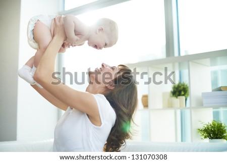 Portrait of joyful mother and son having fun - stock photo