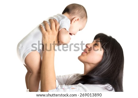 portrait of joyful new mother holding small sweet baby boy isolated on white