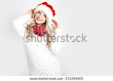 Portrait of joyful pretty woman in red santa claus hat laughing isolated on white background. Beautiful girl looking happy and excited. Happy Christmas and New Year holidays full of fun.