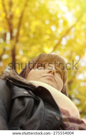 Portrait of joyful woman in nature - stock photo