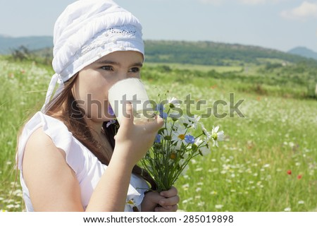 Portrait of kid girl drinking milk