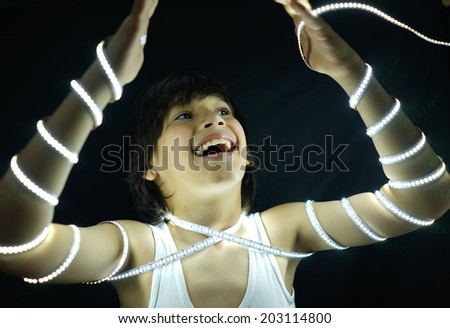 Portrait of kid with led strip light concept - stock photo