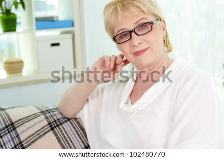 Portrait of kind mature woman looking at camera - stock photo
