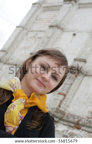 Portrait of lady on the ancient wall background - stock photo