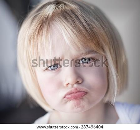 Portrait of lan upset toddler girl - stock photo
