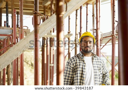 Portrait of latin american construction worker looking at camera - stock photo