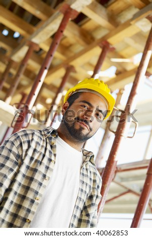 Portrait of latin american construction worker looking at camera. Copy space