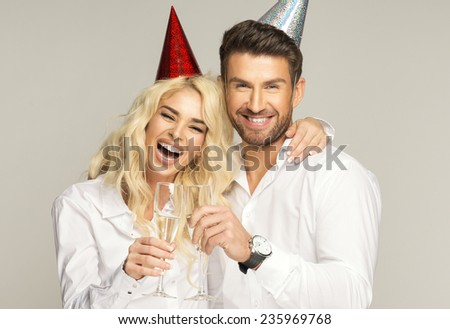 Portrait of laugh couple with glasses of champagne - stock photo