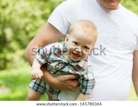 Portrait of laughing baby boy in summer day - stock photo