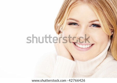 Portrait of laughing blonde in the white sweater, isolated - stock photo