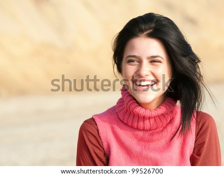 Portrait of laughing girl in pink