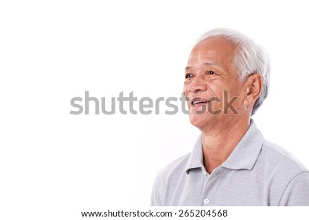 portrait of laughing senior man, looking up at blank space - stock photo