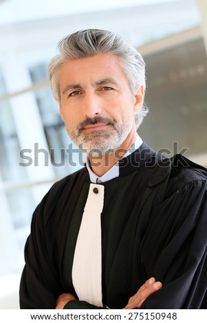 Portrait of lawyer standing in courthouse corrridor - stock photo