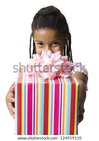 Portrait of little African American girl holding gift box - stock photo