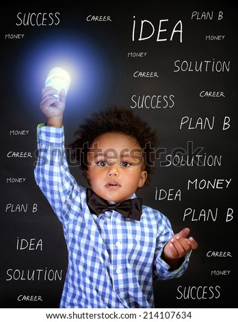 Portrait of little African genius boy with lightbulb in the hand on blackboard background, back to school, find solution concept - stock photo