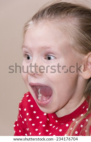 portrait of little angry girl - stock photo