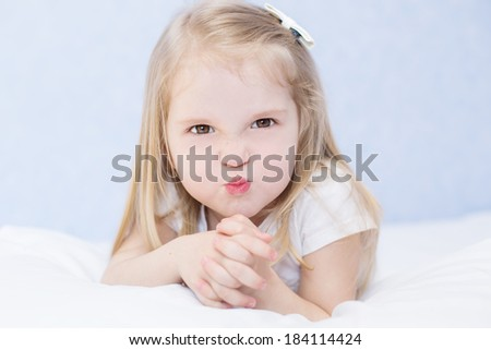 Portrait of little angry toddler girl - stock photo