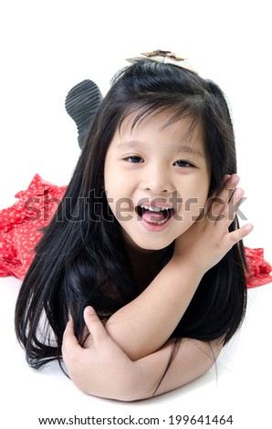 Portrait of Little Asian child in red dress on white background