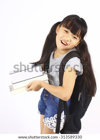Portrait of little asian girl holding the books with backpack, back to school - stock photo