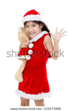Portrait of little Asian girl in red Santa hat on white background