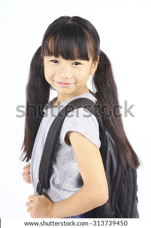 Portrait of little asian girl with backpack, isolated over a white background - stock photo