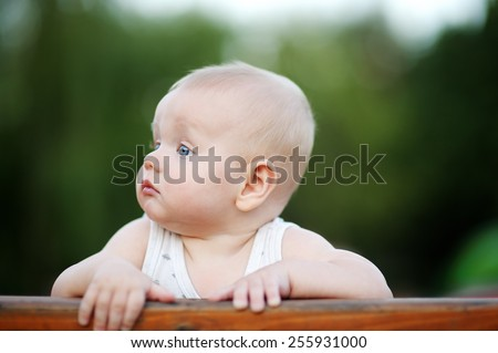 Portrait of little baby boy at summer - stock photo