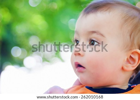 Portrait of little baby boy at summer