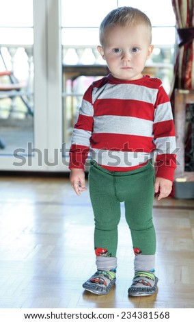 Portrait of little baby boy indoor - stock photo