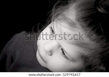 Portrait of little baby girl with cute eyelashes