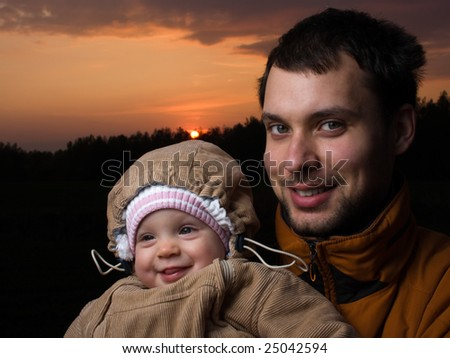 Portrait of little baby with her dad - stock photo