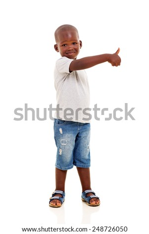 portrait of little black boy with thumb up - stock photo