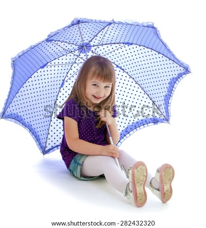 Portrait of little blond sitting on the floor under the umbrella- isolated on white background - stock photo