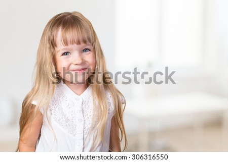 Portrait of little blonde girl at home - stock photo