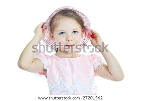 Portrait of little blonde girl in pink holding her hat