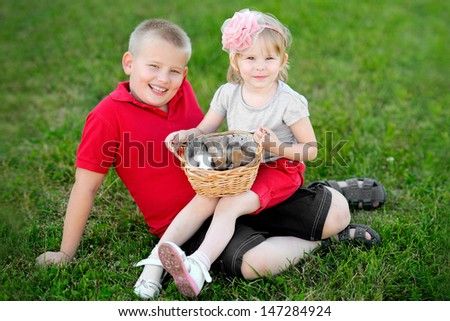portrait of little boy and girl outdoors  - stock photo