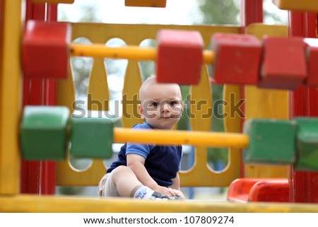 Portrait of little boy at a playground