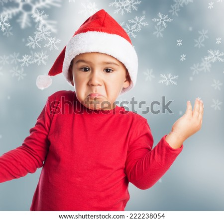 portrait of little boy doubtfully at Christmas
