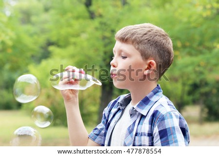 Portrait of  little boy having fun in the park