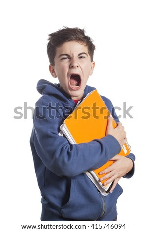 Portrait of little boy holding copybooks over white background - stock photo