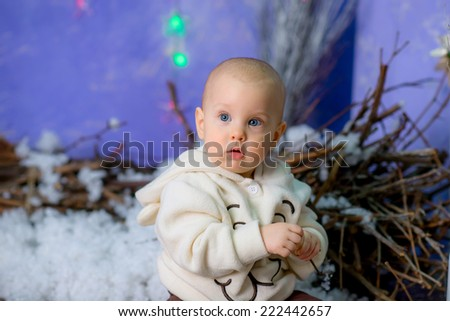 portrait of little boy in Christmas decorations