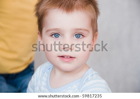 portrait of little boy in home