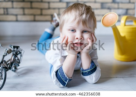 Portrait of little boy in the Studio posing emotions