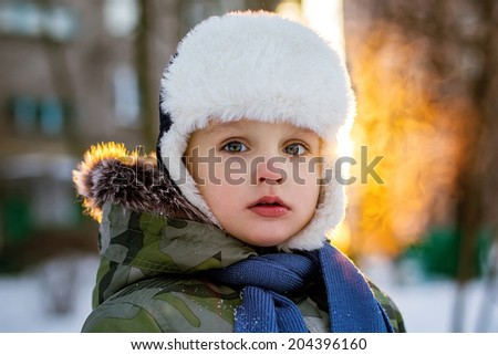 Portrait of little boy in winter clothes - stock photo
