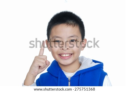 Portrait of little boy looking and pointing  - stock photo