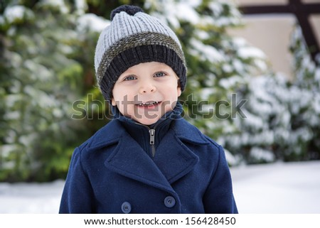 Portrait of little boy on beautiful winter day with snow