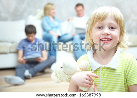 Portrait of little boy on his family background. Selective focus to child. - stock photo