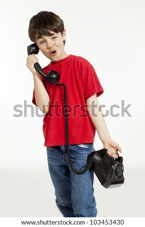 portrait of little boy on the phone, isolated on white background - stock photo