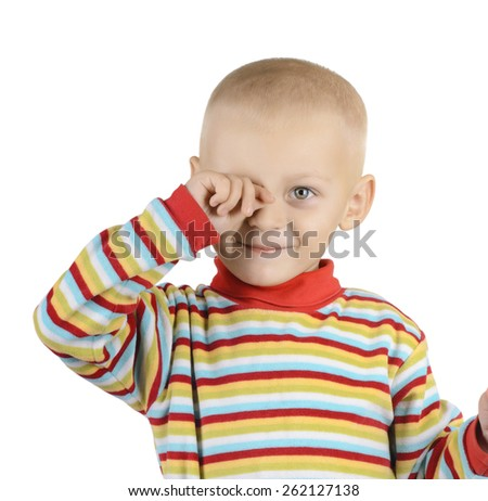 Portrait of little boy rubbing eye with his hand isolated on white background - stock photo