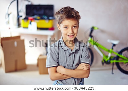 Portrait of little boy standing with arms crossed