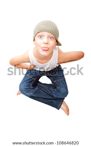 Portrait of  little boy to stick out one's tongue - stock photo
